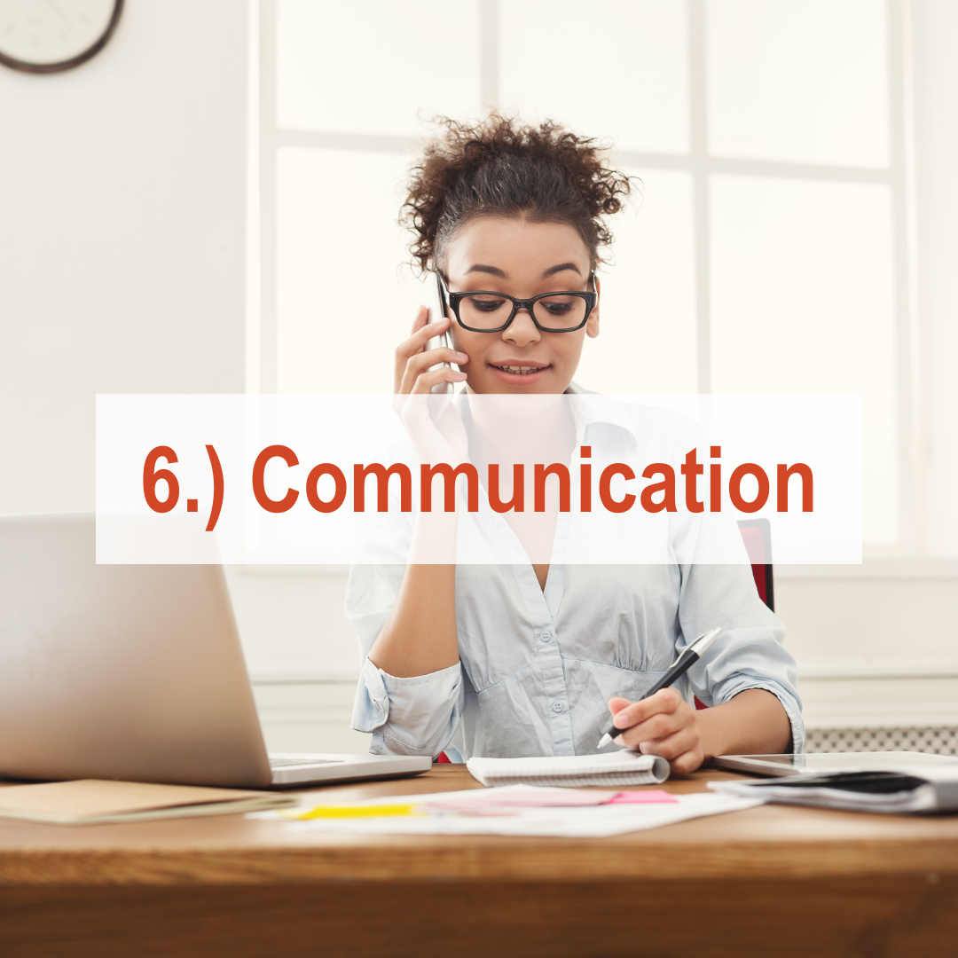 Woman sitting at desk talking on phone and looking at computer | Communication