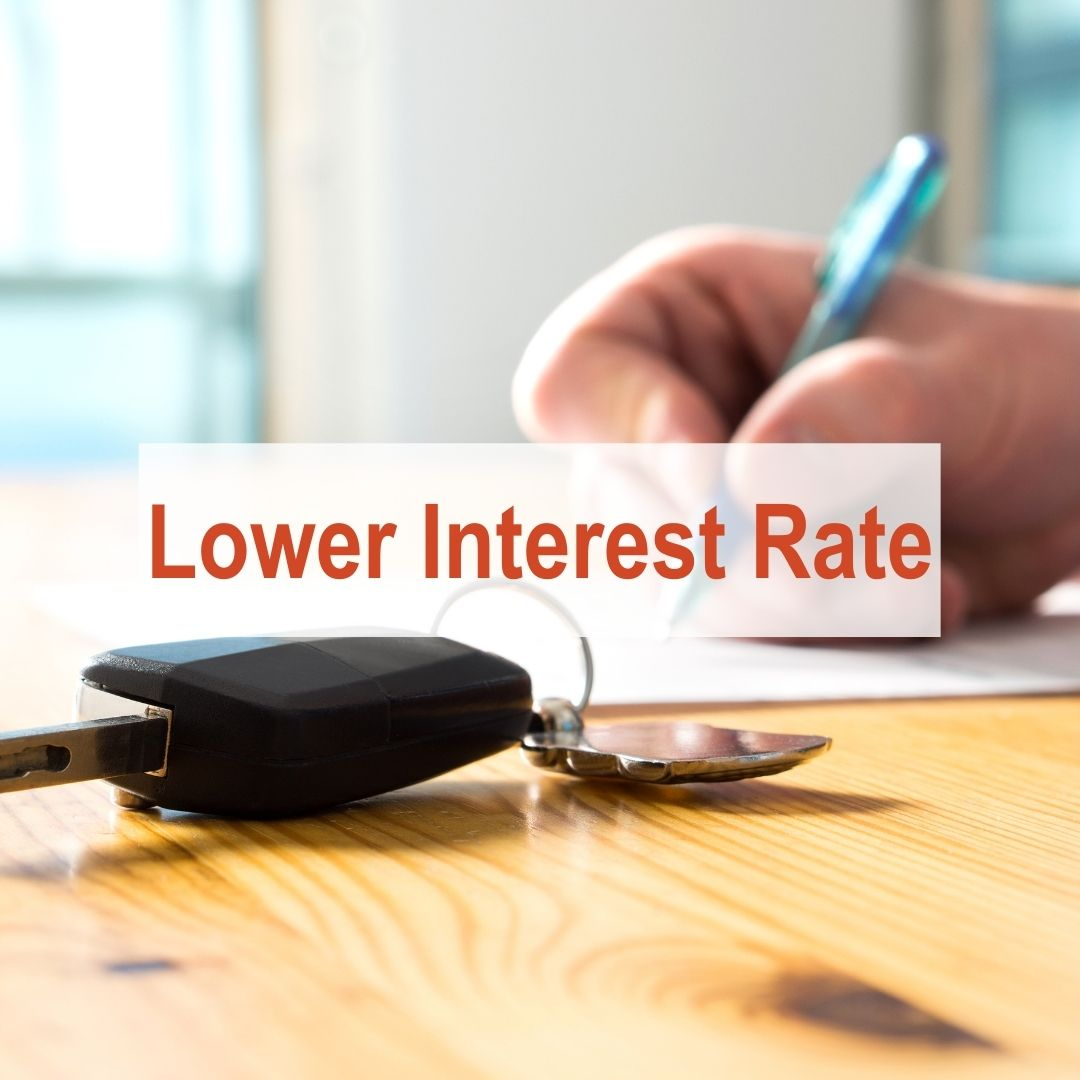 Person writing with pen and car keys setting next to him | Low Interest Rate