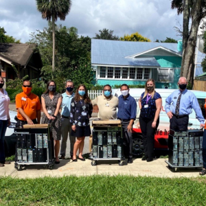 group of Volusia County workers donating computers from Launch