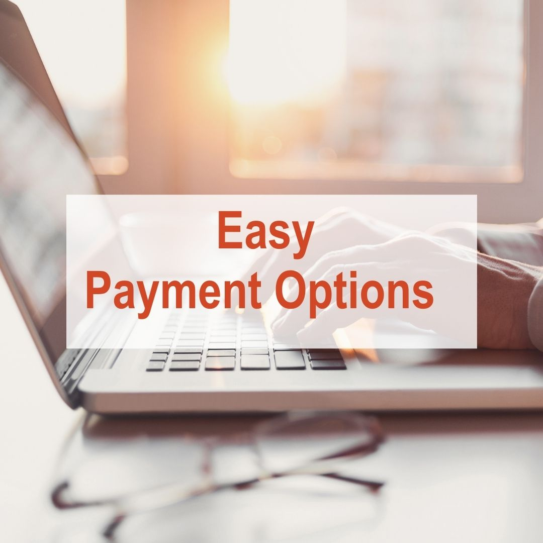 hand typing on computer with sun shining in window | Easy Payment Options