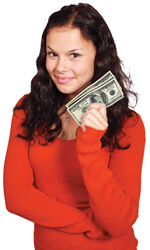 girl with orange sweater holding money
