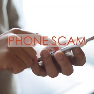 Person holding a cell phone typing | Phone Scam