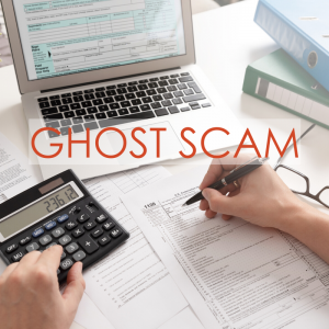 a desk filled with papers, a calculator, pen, and laptop | Ghost Scam