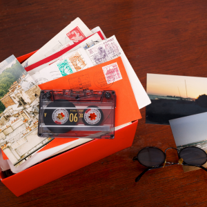 a shoebox filled with cards, tapes, and memories.