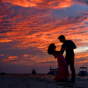A sunet with two people dancing