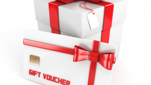 White and red gift box with gift card in front