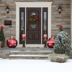 Brick home front door with Christmas wreath and decorations. Avoid Holiday Travel Stress