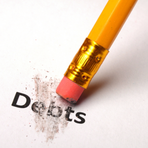 white background with pencil erasing word debt. Jump Start 2020 Financial Resolutions
