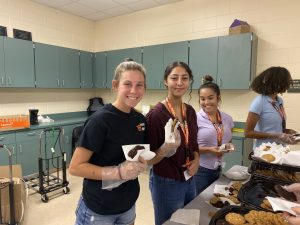 students serving cookies