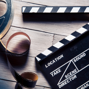 A film reel and movie clap board.