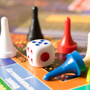 A board game with white, black, red, and blue pieces.