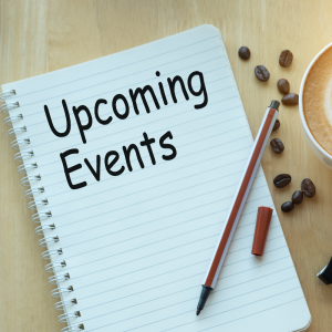 A notebook with a pen laying ontop and coffee next to it | Upcoming Events.