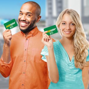 A man and a woman holding a $10 gift card to Subway