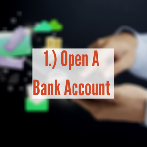 Hands typing on a phone   Open A Bank Account