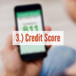 A person holding a phone with credit score displayed   Credit Score