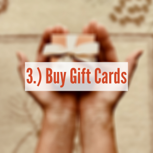 A set of hands holding a gift card box
