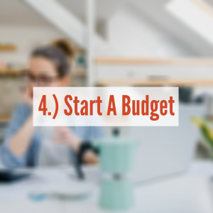 A women sitting at a table on her laptop | Start A Budget