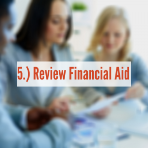 Two women looking at papers together   Review Financial Aid