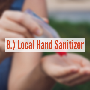 a hand squirting hand sanitizer into their hand