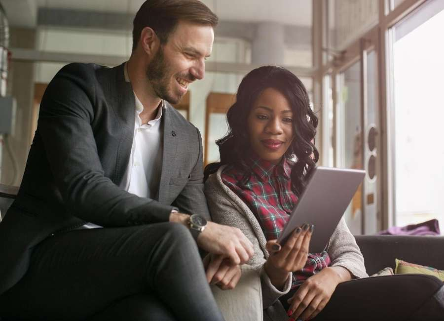 2 people viewing tablet