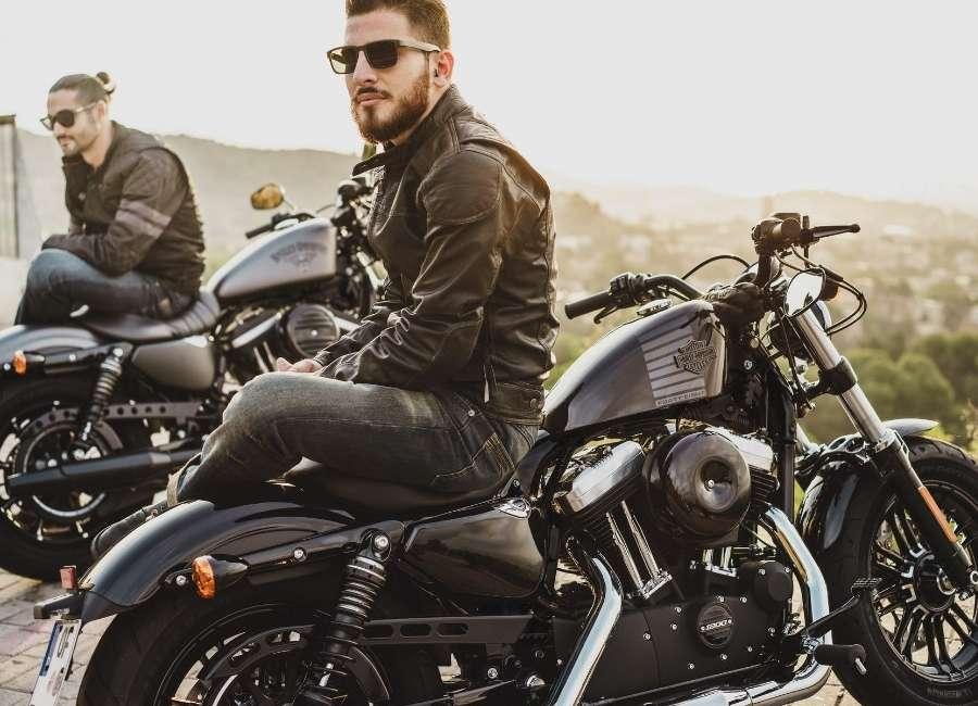 2 men sitting on their motorcycle