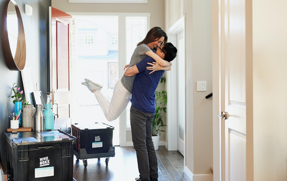 Couple Embracing in New Home