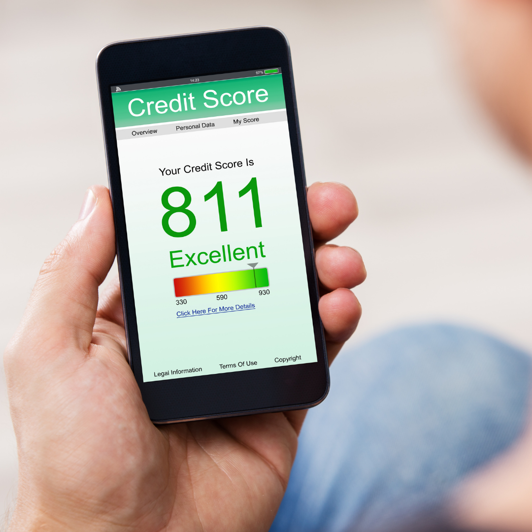 Person holding phone with credit score on it