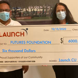 holding giant check