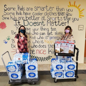 donating water bottles and snacks at local Brevard County elementary school