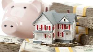 Piggy bank, money, and home figurine