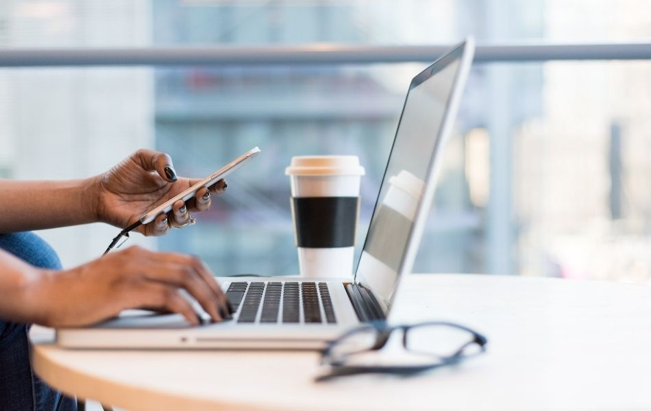 Woman using digital banking on desktop and phone