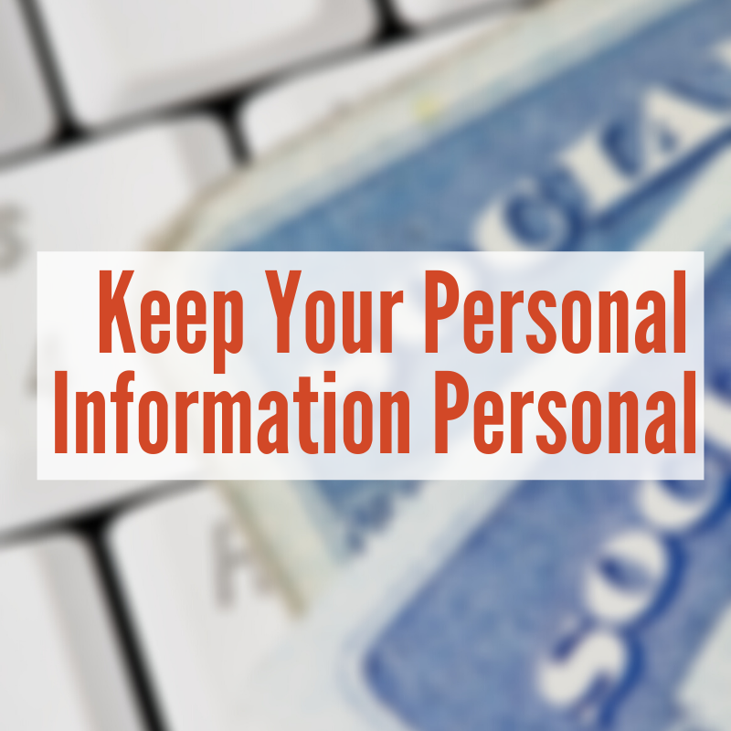 social security cards sitting on keyboard | Keep Your Personal Information Personal