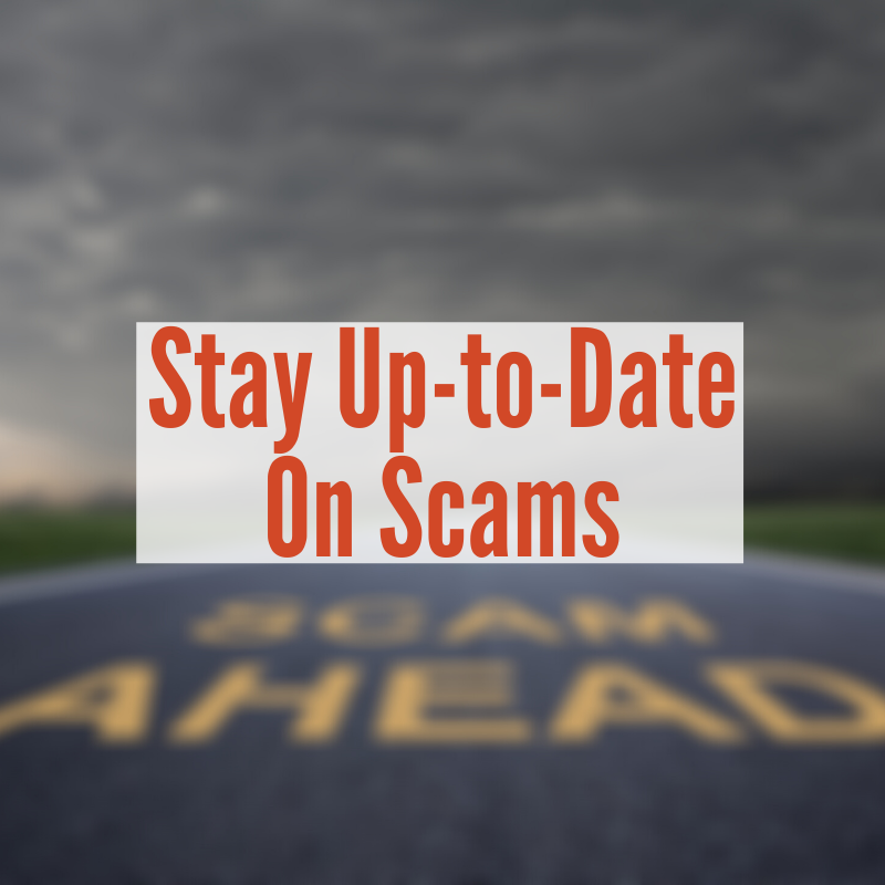 road with yellow letters scam ahead | Stay Up To Date on Scams