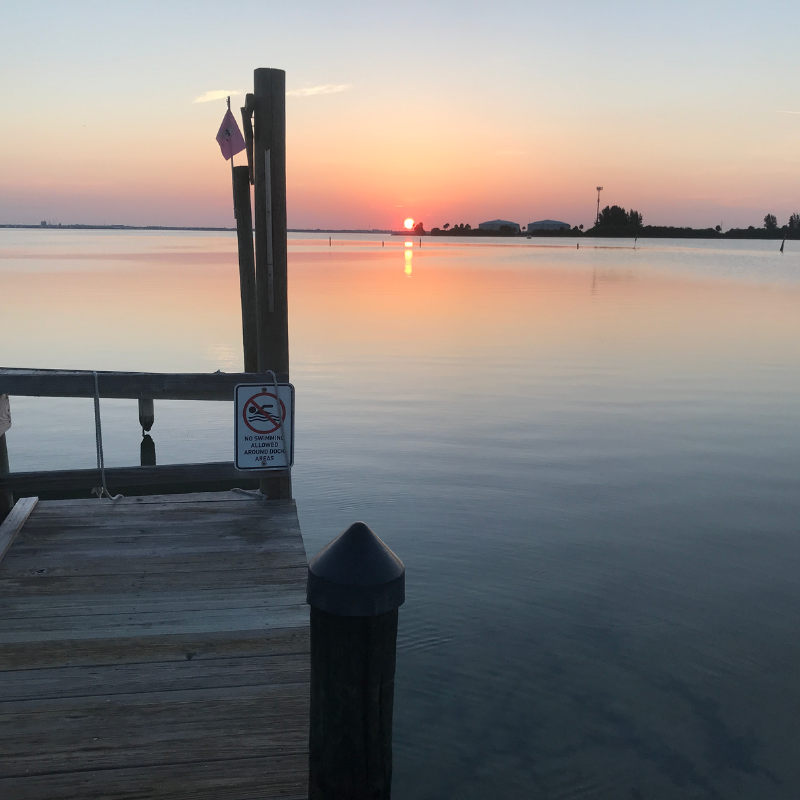 A sunrise from a dock