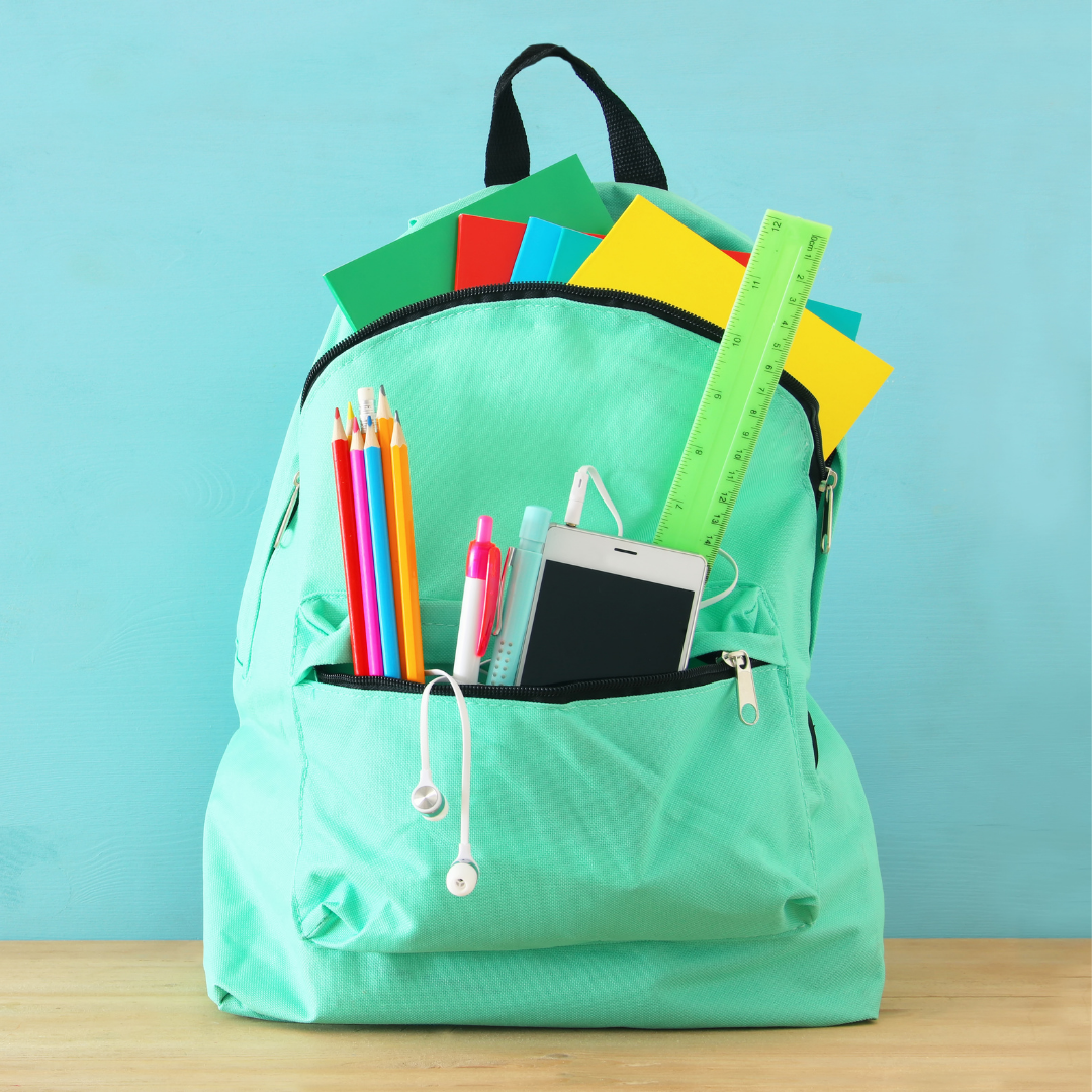 A teal backpack filled with school supplies