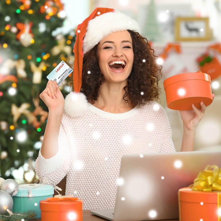 Woman in Santa Hat Shopping Online