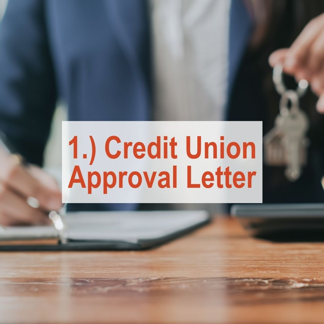 close up of hand writing on table holding keys in other hand | Credit Union Approval Letter