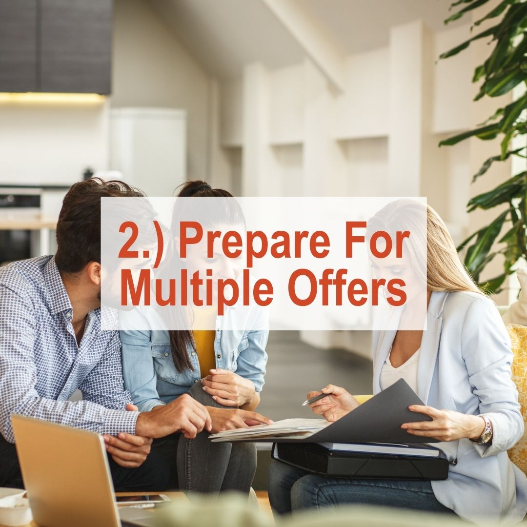 a couple sitting with real estate agent going over papers | Prepare For Multiple Offers