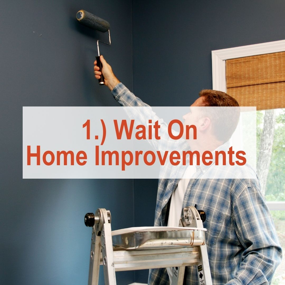 A man painting a wall grey | Wait On Home Improvements