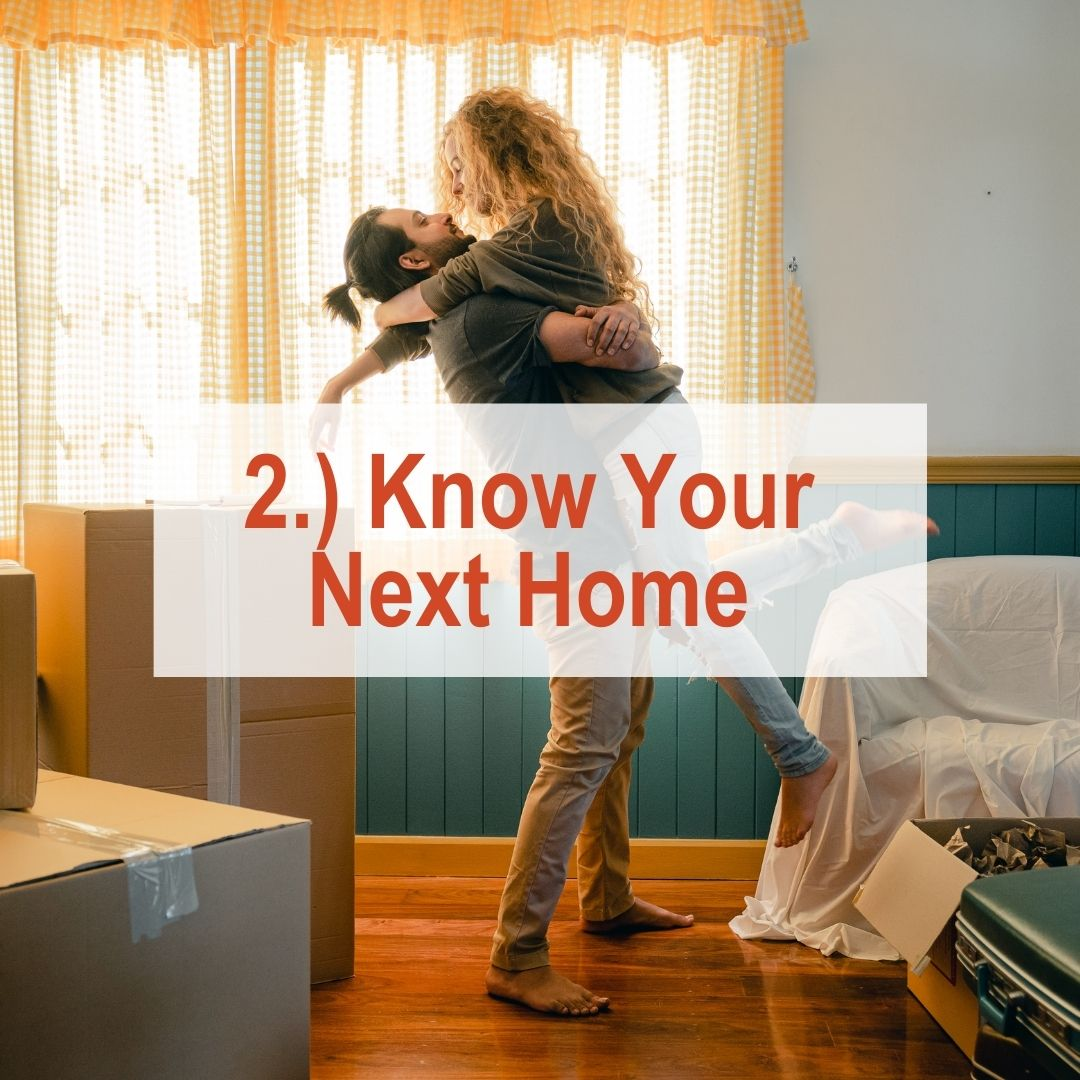 a man holding a woman up in room with boxes | Know Your Next Home