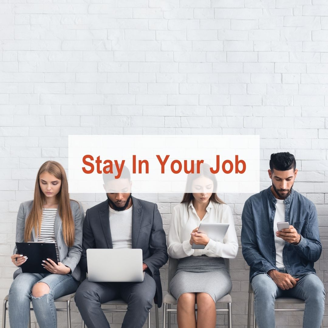 4 people sitting in chairs | Stay In Your Job