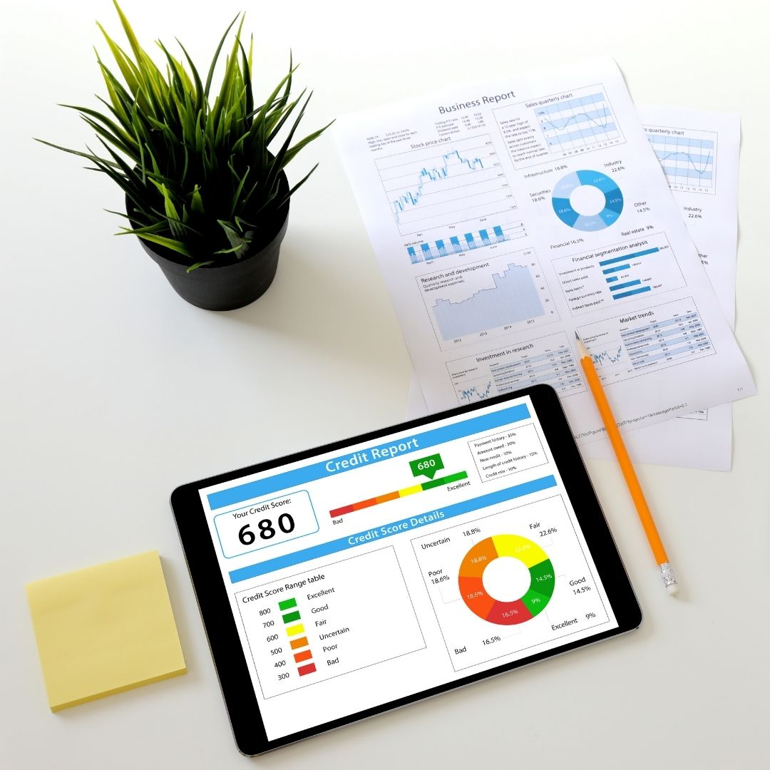 desk with ipad and papers featuring credit score information