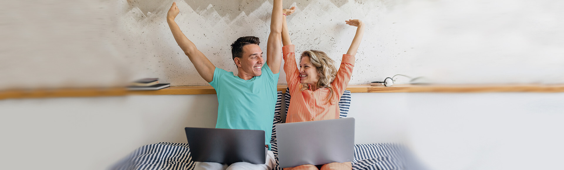 Couple Applying Online From Their Bed- Apply Anywhere