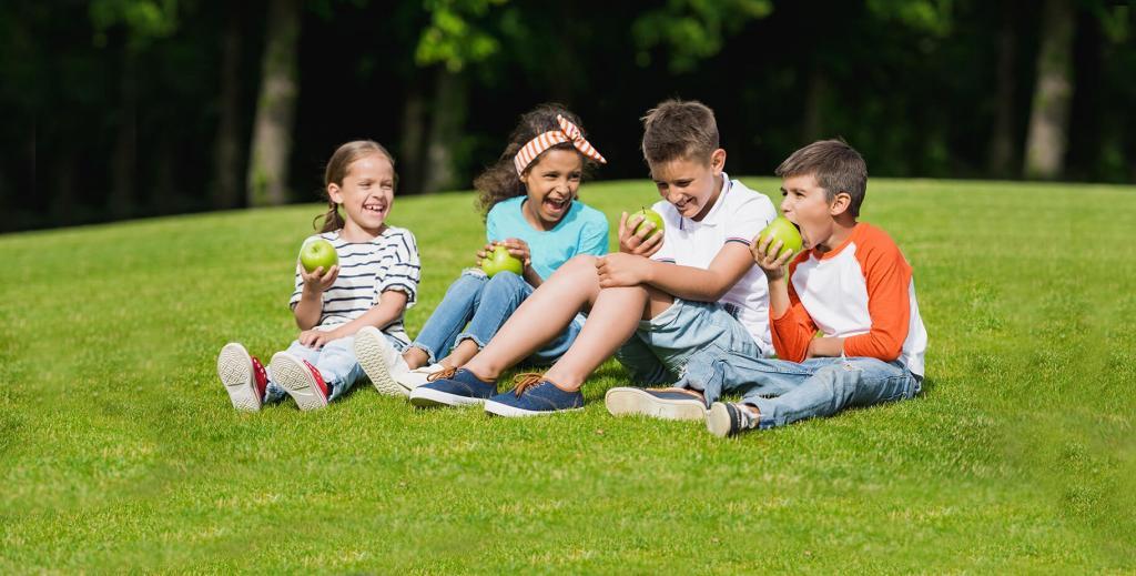 Group of kids eating apple